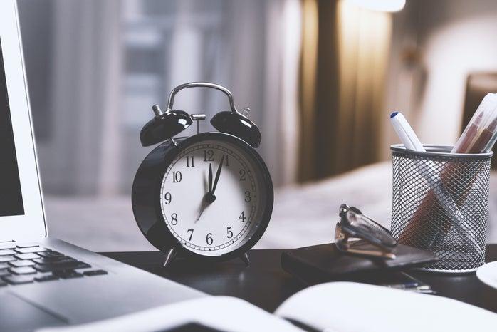 black alarm clock on desk