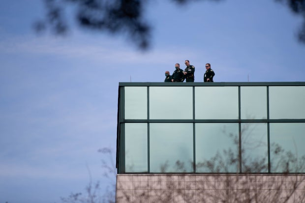 a group of 4 law enforcement officers on the roof of a government building in Tallahassee, Fl