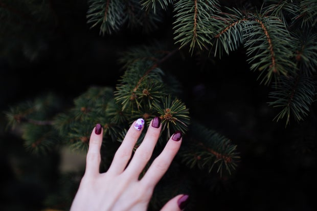 red nails on a dark green background