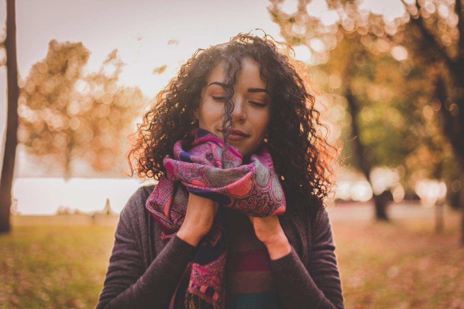 woman outside wearing scarf