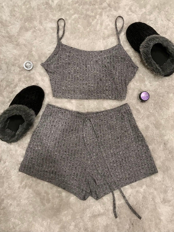 Gray pajama set from SHEIN. Black slippers, white carpet, lush lip care