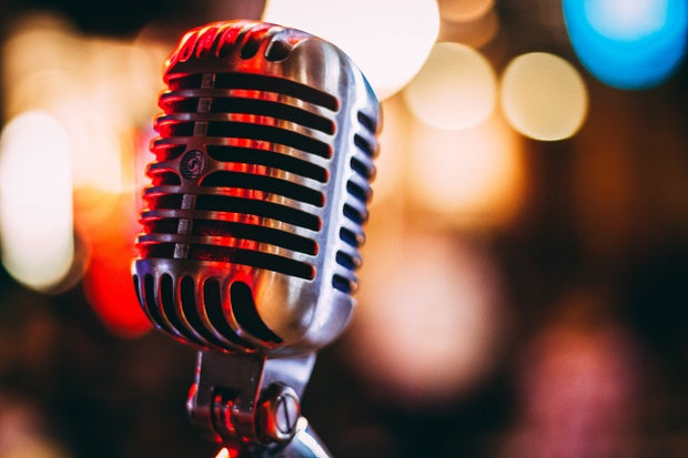 vintage microphone with colorful lights in the background