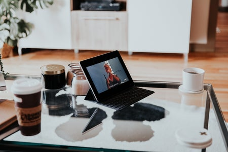 laptop on glass coffee table