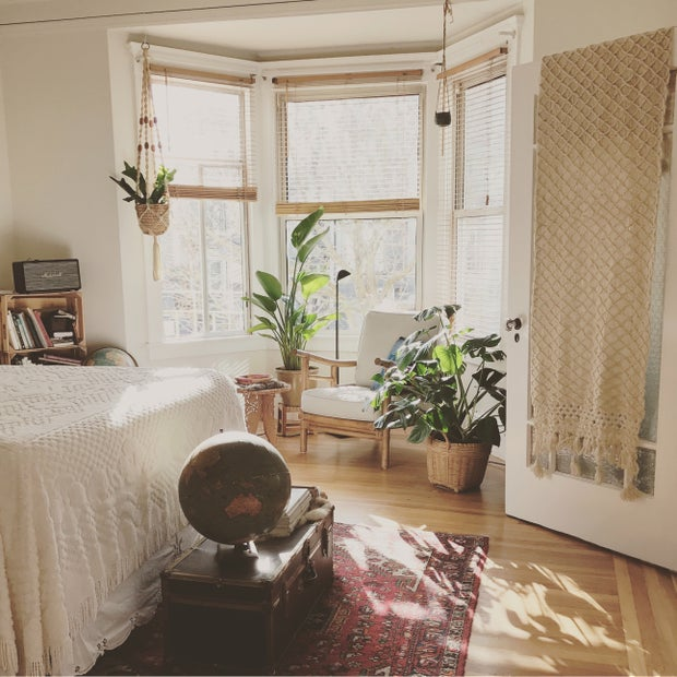 boho bedroom with plants and macrame