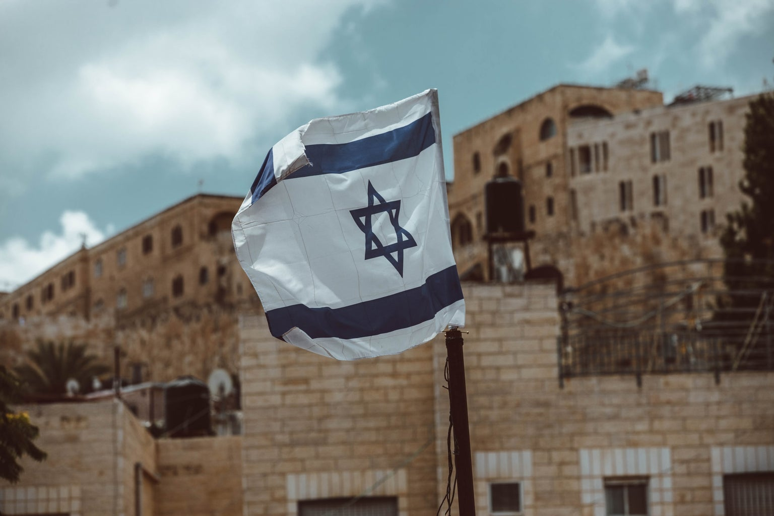 Israel blue and white flag on pole