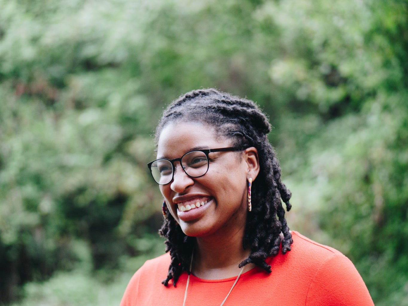 black woman with braided hair smiling