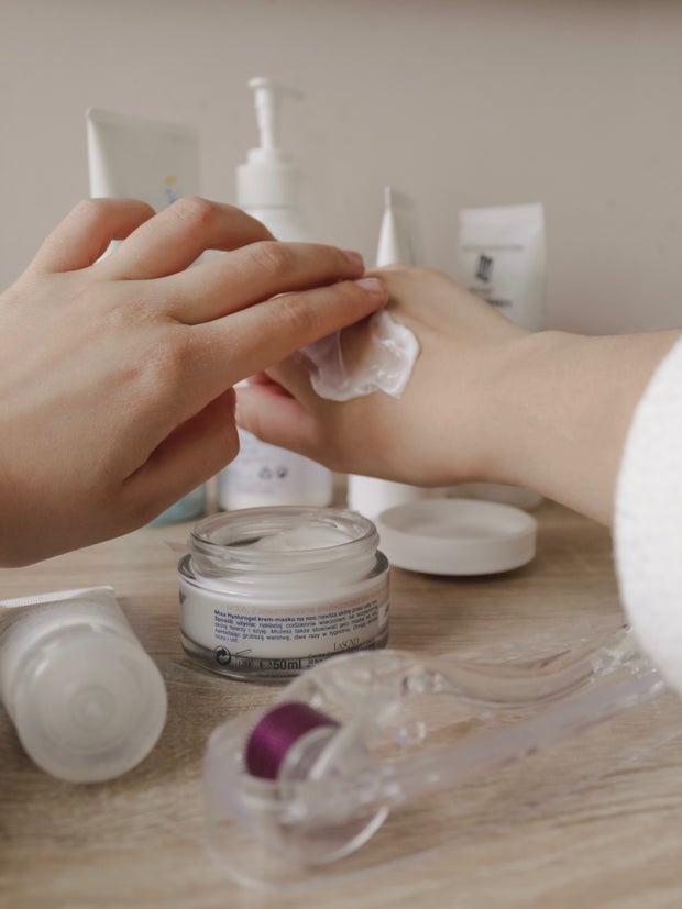 person using cream on hand
