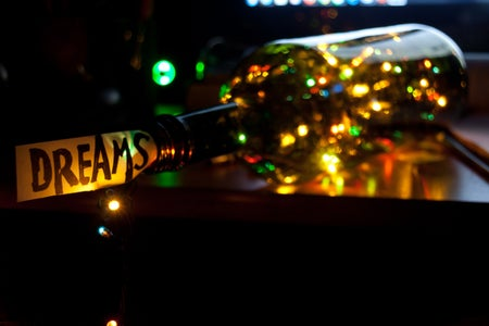 "Bottle of lights with the word ""dreams"""