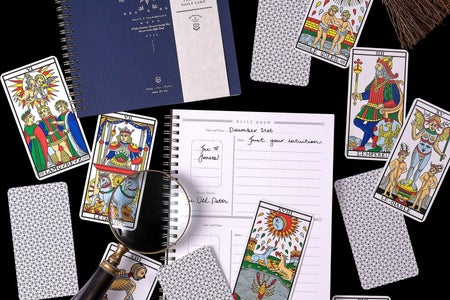 cards and stationary with magnifying glass
