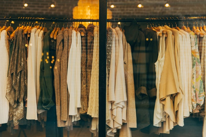 Clothing rack of brown tops