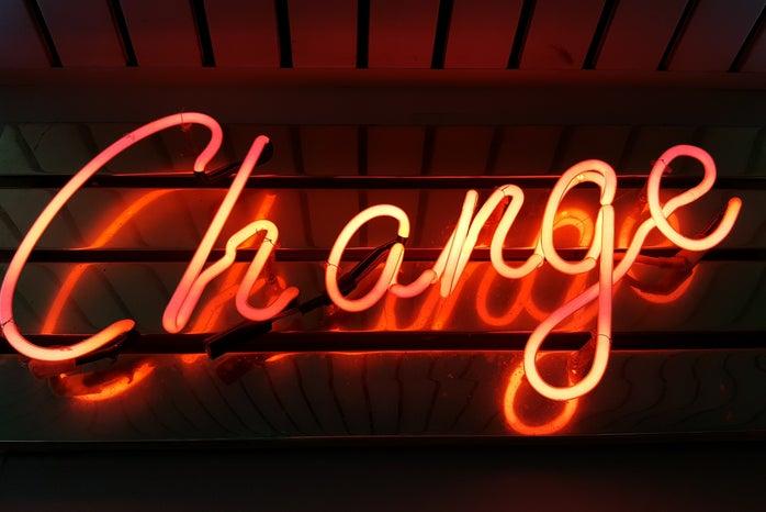 \'Change\' in an orange neon sign
