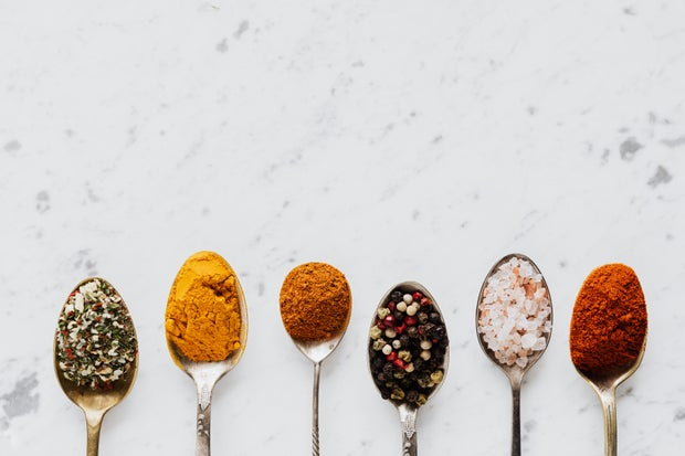 Composition of spoonfuls with various spices for healthy food preparing