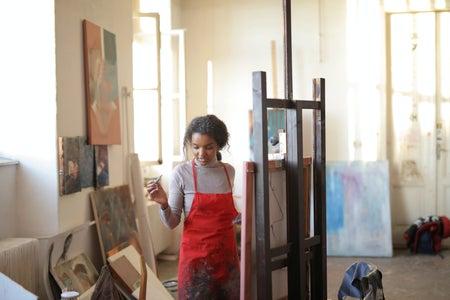 woman artist painting in studio