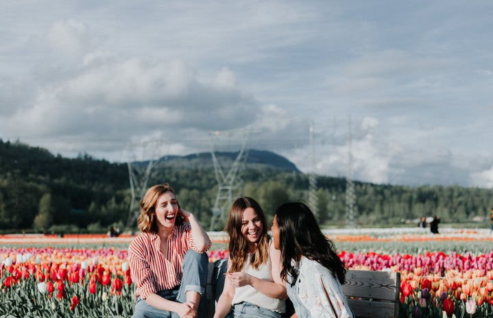 Women laughing in a tulip field