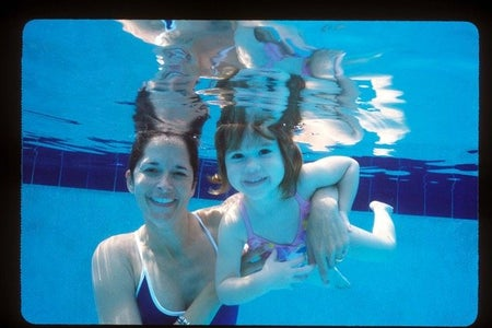 mom and daughter swimming