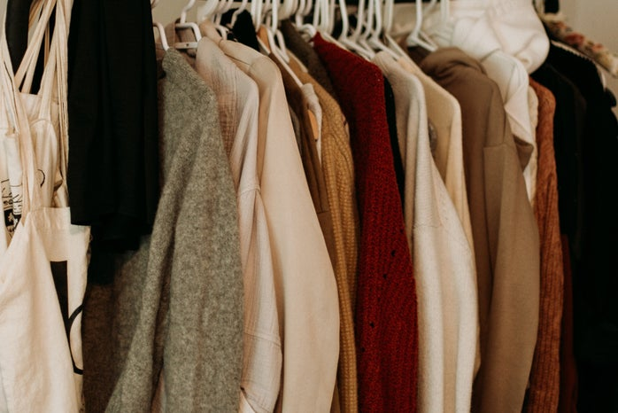 closet with fall tone clothes