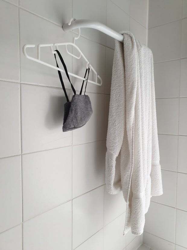 Towel and bra hanging in shower