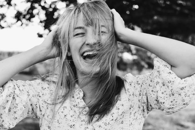 woman with bangs smiling
