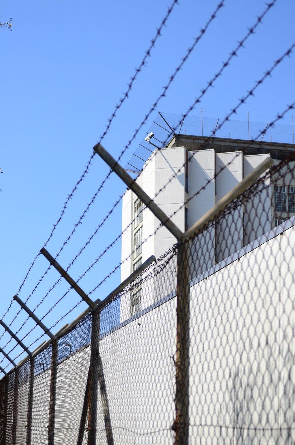 prison fence white building