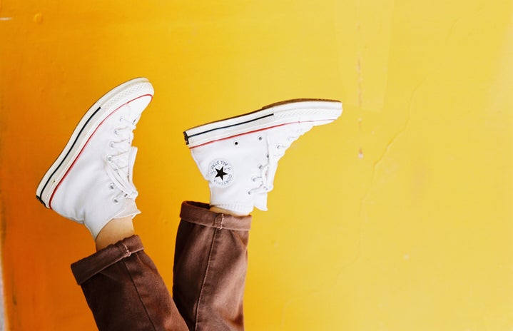 Person wearing converse hightop sneakers