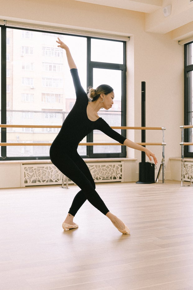 Woman dancing ballet by herself