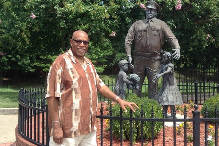 Fred Lee Jr with Statue