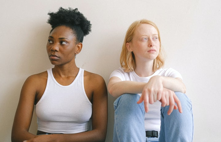 Women Sitting Close Together