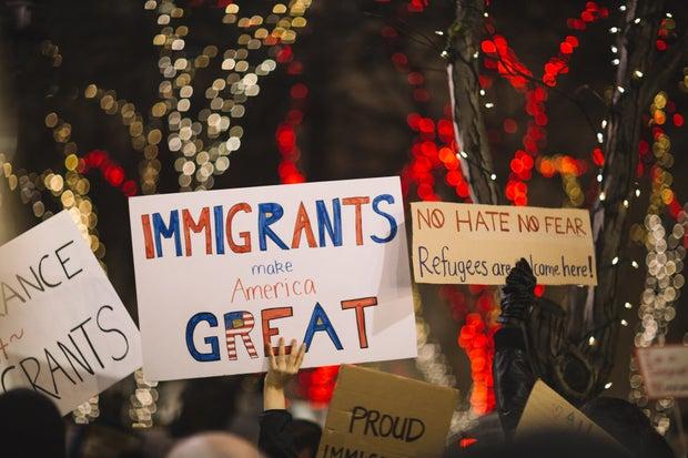 """Immigrants make America great"" sign"