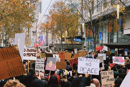 people standing on street during daytime with protest signs