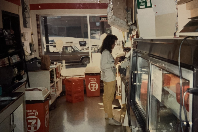 Vintage photo of woman working the register at 7-Eleven