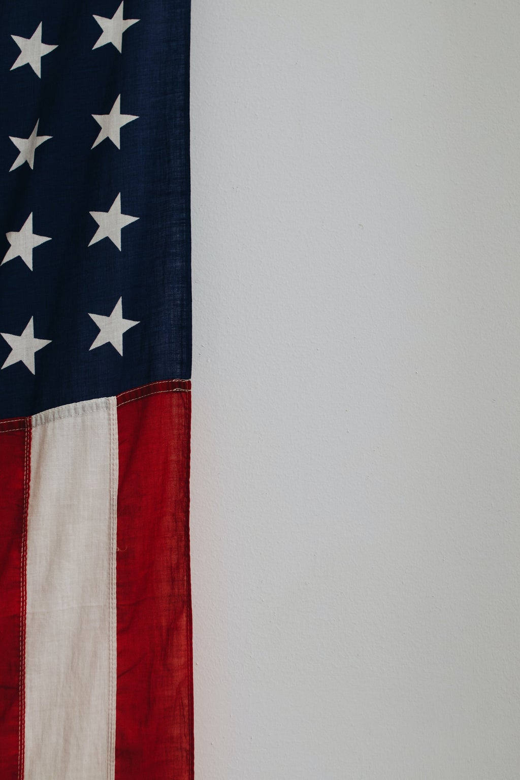 A portion of the American flag with a white background.