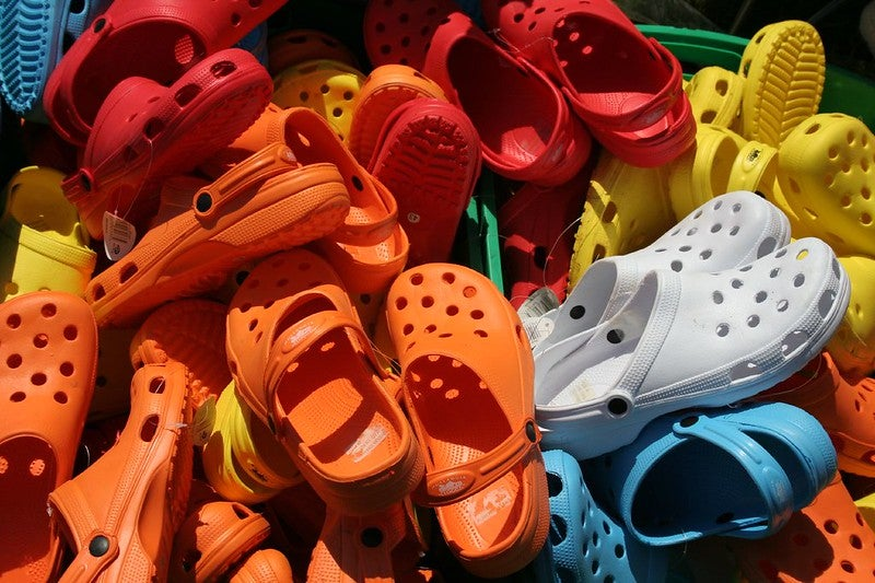 colourful crocs shoes in a pile