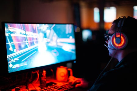 man with a headset playing a computer video game