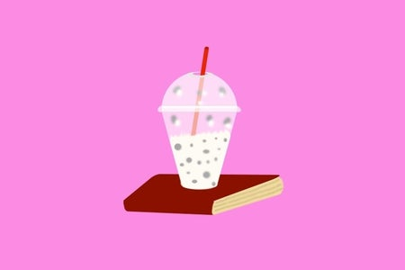 An illustration of a milkshake on top of a book.