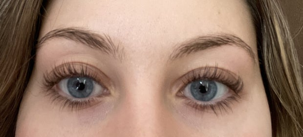 girl without mascara on from front