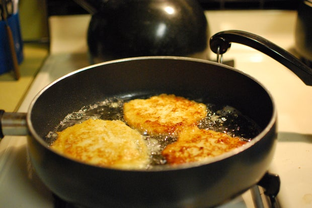 potato latkes frying in pan