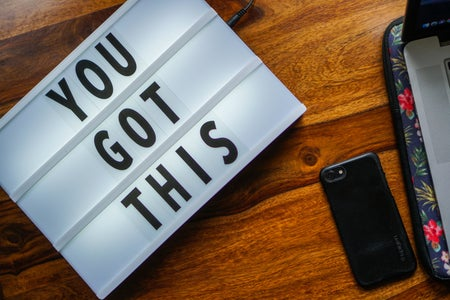 """You Got This"" sign with iPhone next to it"