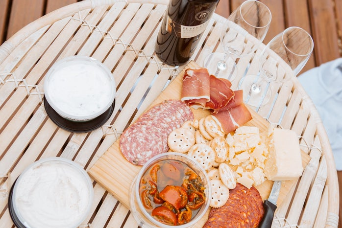 meats and biscuits tray beside wine glasses