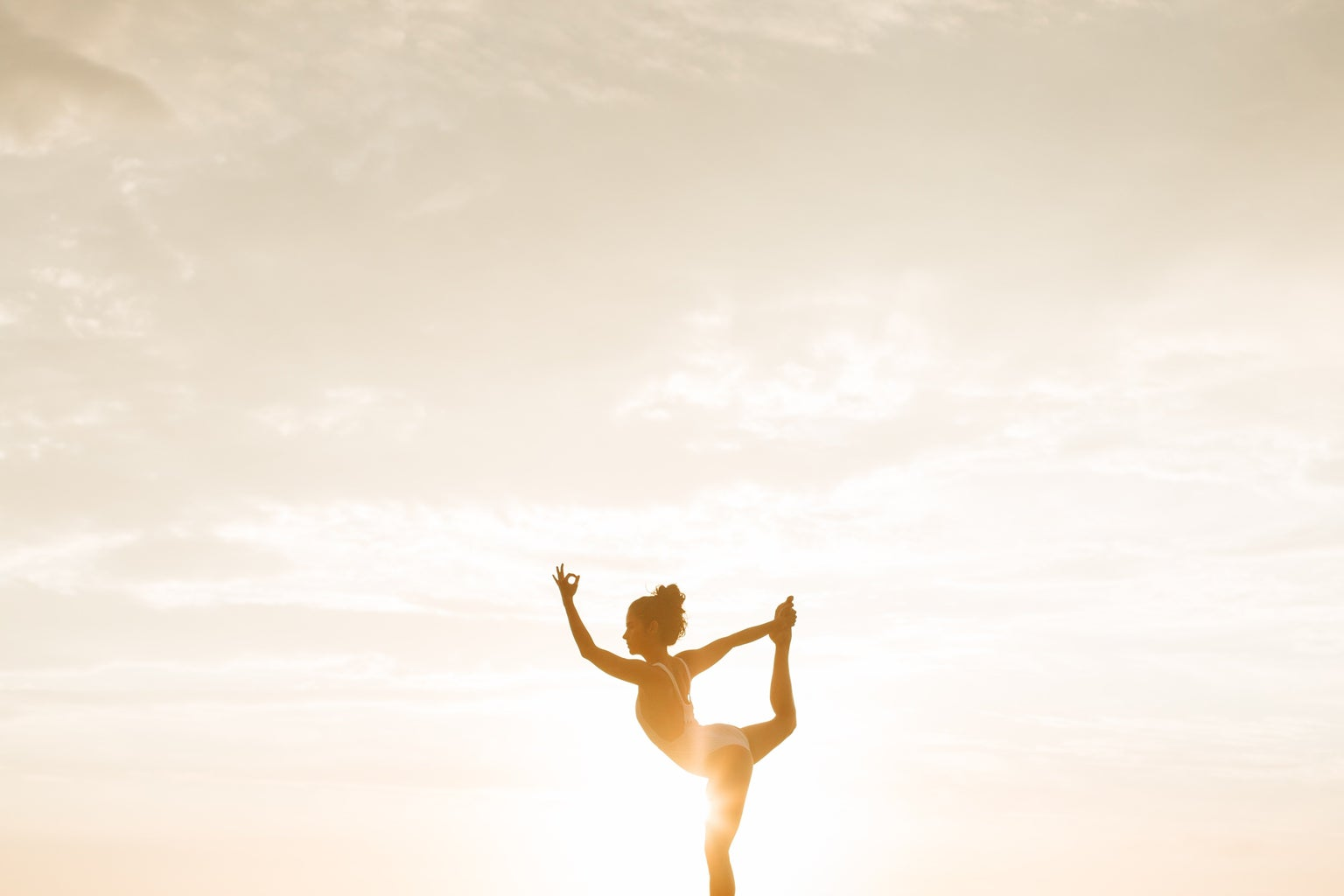 woman doing a yoga pose during golden hour