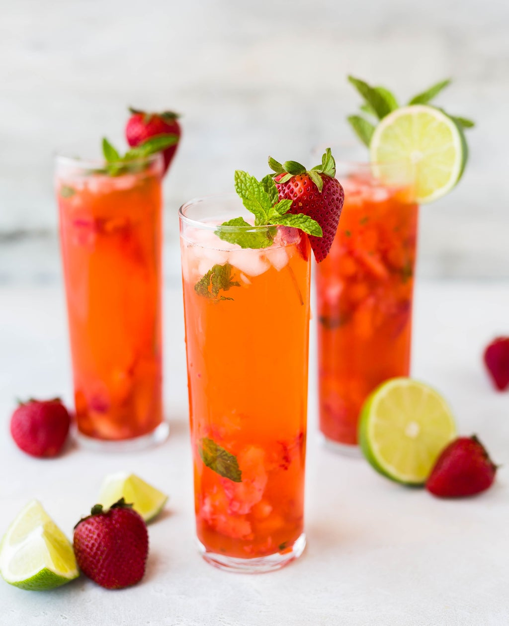 Three glasses of strawberry cocktails