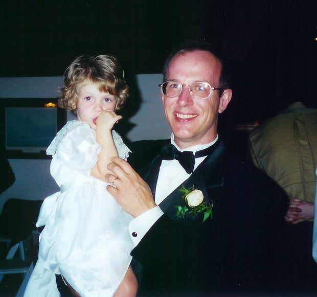 Father and daughter at wedding.