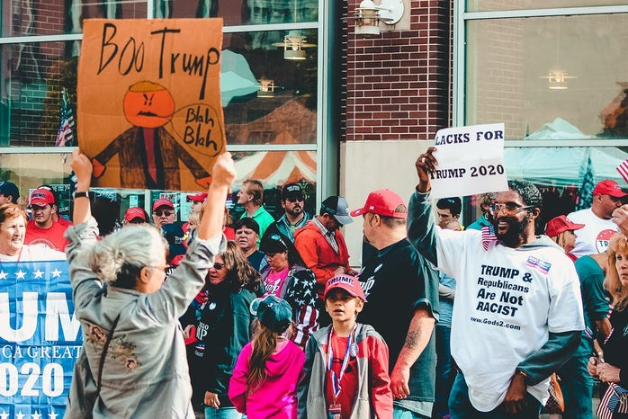 two opposing political opinions meet at a protest