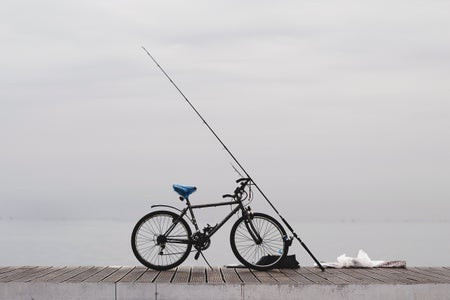 bicycle on dock with fishing pole