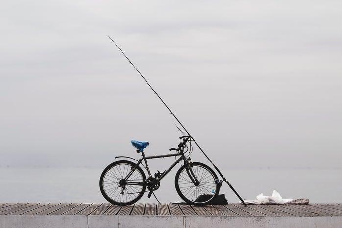 bicycle on dock with fishing pole