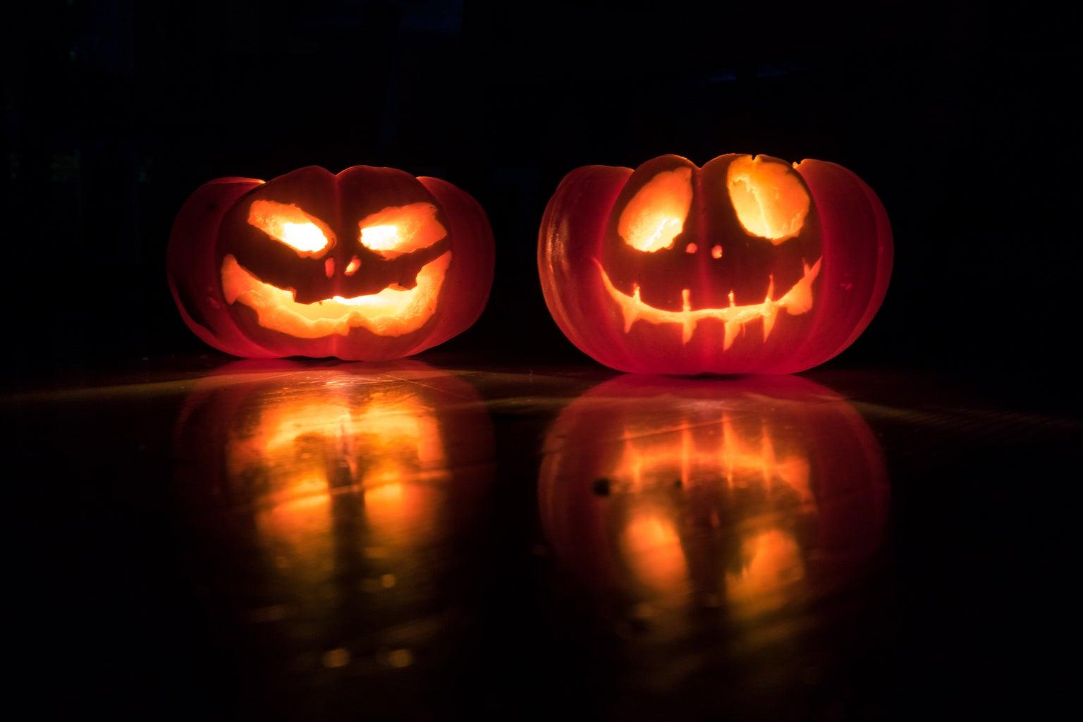 2 jack-o-lanterns in the dark