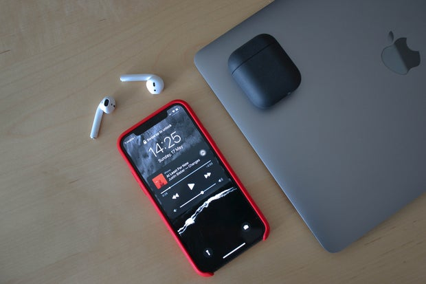 Phone on table with music playing