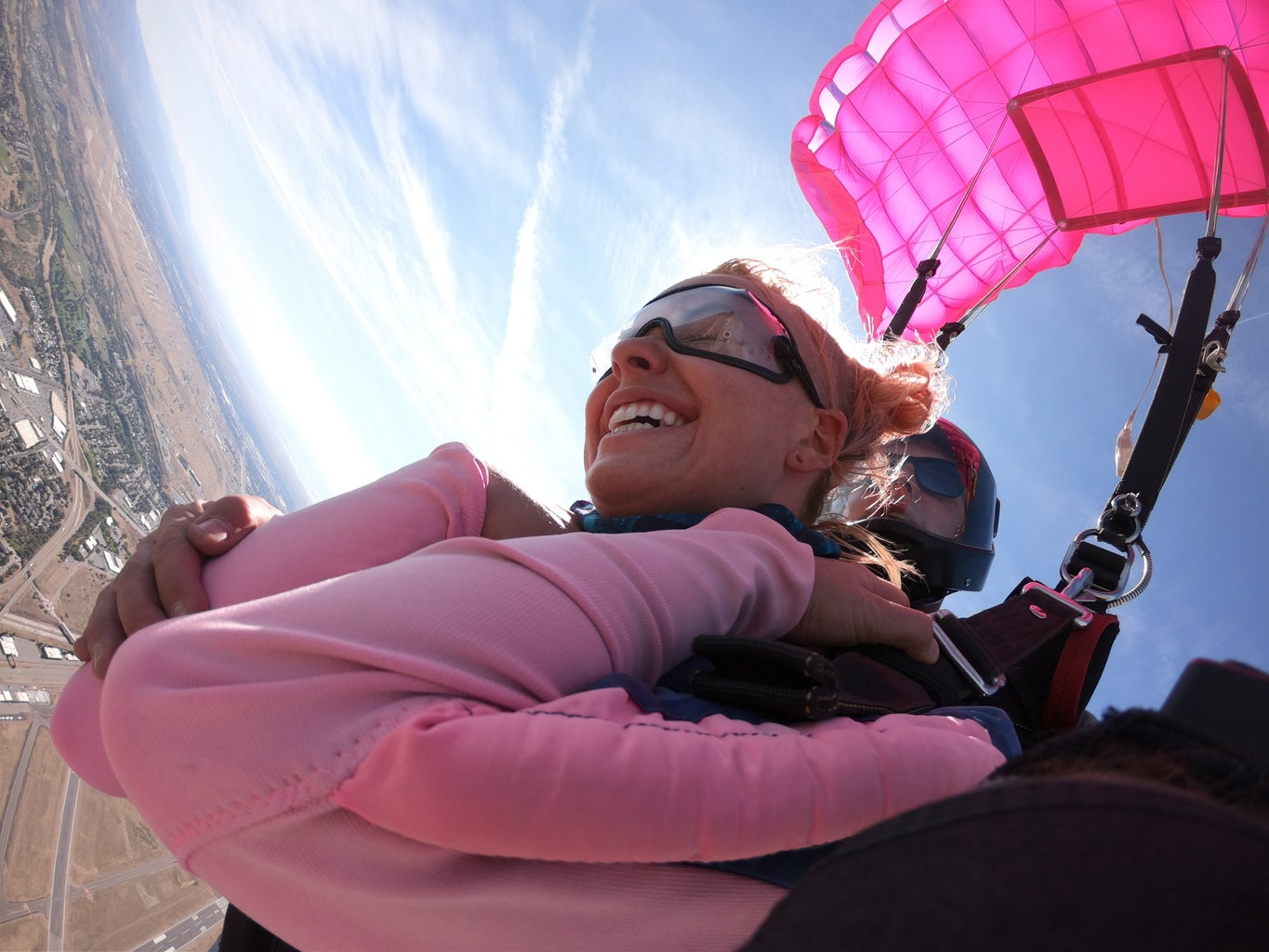 Madison Skydiving with her pink parachute