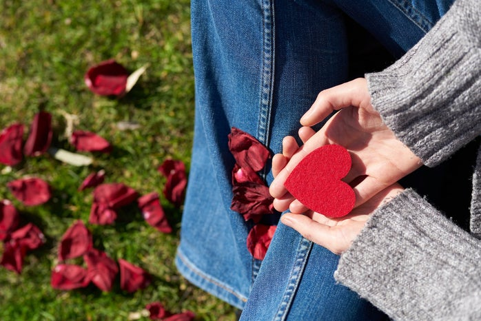 person holding hearts