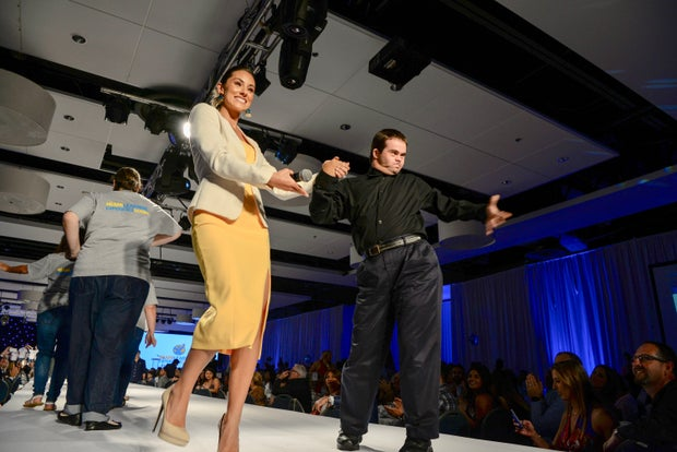 Nikki Sapp-Spoelstra on a runway with a student
