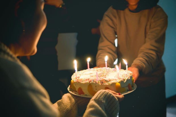 Cake with lit candles